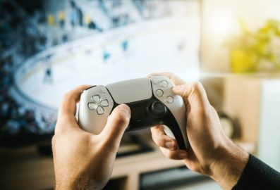 person holding ps5 controller